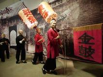 Chinese sedan chair team leaders. Models of Chinese sedan chair team in Hong Kong Heritage Museum stock image