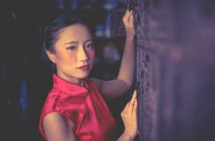 Chinese seller worker in a steel metal store shop. Chinese teenager seller worker in a steel metal store shop royalty free stock photo