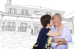 Chinese Senior Adult Couple Hug In Front Of House Drawing. Chinese Senior Adult Couple Kissing In Front Of Custom House Drawing Plans royalty free stock photos