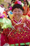 Chinese senior woman in colorful traditional silk cloth dancing