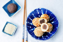 Chinese sesame balls with sweet red bean paste. On a white background. toning. selective focus Royalty Free Stock Images