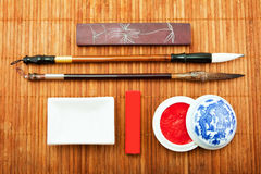 The Chinese set for calligraphy, the art of calligraphy, brush f. Or Chinese painting, bamboo brush, Chinese ink, goods for calligraphy Stock Images