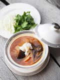 Chinese Shark`s Fin Soup with crab meat, sea cucumber and conch in brown soup. Chinese Shark`s Fin Soup with crab meat, sea cucumber and conch in brown sauce Stock Photos