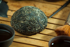 Chinese shen puer tea. Shen puer chinese tea tuo cha on chaban tea table whis tea acessories in Traditional chinese tea ceremony Royalty Free Stock Photos
