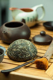 Chinese shen puer tea. Shen puer chinese tea tuo cha on chaban tea table whis tea acessories in Traditional chinese tea ceremony Royalty Free Stock Photo