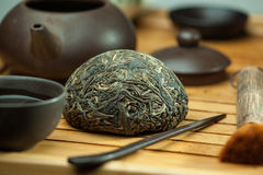 Chinese shen puer tea. Shen puer chinese tea tuo cha on chaban tea table whis tea acessories in Traditional chinese tea ceremony Royalty Free Stock Image