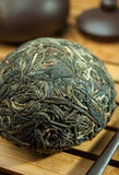 Chinese shen puer tea. Shen puer chinese tea tuo cha on chaban tea table whis tea acessories in Traditional chinese tea ceremony Stock Photo