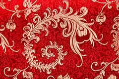 Chinese shiny ornament on red fabric Royalty Free Stock Photos