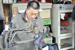 Chinese shoemaker. At work in zhuhai,guangdong china. Photo taken at 16th of March 2011 royalty free stock images