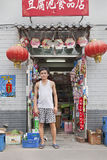 Chinese shop owner in front of his store, Beijing, China Stock Photo