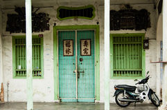 Chinese shophouse facade, George Town, Penang, Malaysia. GEORGE TOWN, PENANG, MALAYSIA - SEPTEMBER 4, 2013: Typical old painted Chinese shophouse facade in Stock Photo