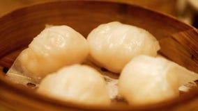 Chinese Shrimp steamed dumpling. In bamboo stock video