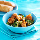 Chinese shrimp stir fry in colorful table setting Stock Photo
