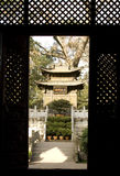 Chinese shrine through the doorway Royalty Free Stock Photos