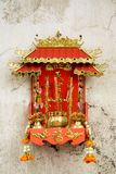 Chinese Shrine hang on the broken cement wall. In China Town stock photo