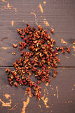 Chinese Sichuan pepper. On old wooden background Stock Image