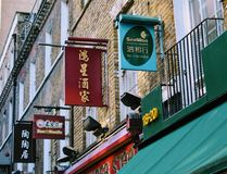 Chinese signs. On buildings in Chinatown, London Royalty Free Stock Photo