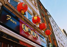 Chinese signs  and lanterns. Signs and lanterns on restaurant  in Chinatown, London Royalty Free Stock Images