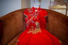 Chinese silk dress. Chinese traditional silk wedding dress close-up royalty free stock image