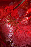Chinese silk fabric. Closeup oriental cheongsam, focus on the button Royalty Free Stock Images