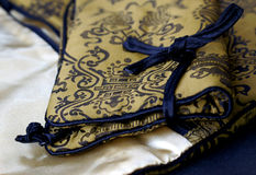 Chinese Silk purse. Gold and embroidered purse made from chinese silk with pattern Stock Photo