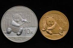 Chinese Silver Panda Vs. Chinese Gold Panda Stock Photography