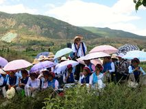 Chinese Singers at Outdoor Singing Festival. Chinese Bai ethnic singers in Dali celebrate Raosanling, a festival that includes singing outdoors at the foot of a royalty free stock photos