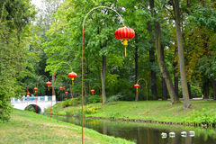 The Chinese small lamps on the bank of the channel in the Lazenki park. Warsaw, Poland Stock Image