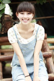 Chinese smiling girl outdoor. Charming Asia girl smiling outdoor in summer Royalty Free Stock Photo