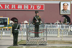 Chinese Soldiders - Mao. Chinese soldiers standing guard on the Tiananmen Square Beijing in Front of a Mao photography Royalty Free Stock Photo