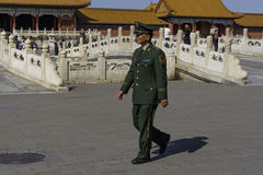 Chinese Soldier  Patrols in the Forbidden City. Beijing, China April 3, 2016  A Soldier Patrols the Grounds of  The Forbidden City in Beijing, China. Editorial Stock Image