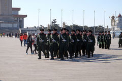 Chinese soldiers march in Tiananmen square in Beijing. Chinese soldiers march in Tiananmen square. It is the third largest square in the world and important site Stock Photo