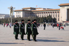 Chinese soldiers march in Tiananmen square in Beijing. Chinese soldiers march in Tiananmen square. It is the third largest square in the world and important site Stock Image