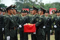 Chinese soldiers raising the flag. The Peoples Liberation Army Hong Kong Garrison is a garrison of the Peoples Liberation Army (PLA) of the Peoples Republic of Royalty Free Stock Image