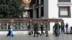 Chinese soldiers walking at the Jokhang temple. Tibet, China - Sep 7, 2012. Chinese soldiers walking around Jokhang temple in Lhasa, Tibet. The Jokhang Temple Royalty Free Stock Images