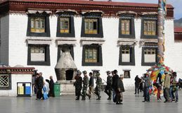 Chinese soldiers walking at the Jokhang temple. Tibet, China - Sep 7, 2012. Chinese soldiers walking at the Jokhang temple in Lhasa, Tibet. The Jokhang Temple Stock Image
