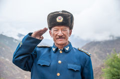 Chinese soldiers. Yunan,China - October 25 ,2008 : Old Chinese soldiers at beside the road in Shangri-la(Zhongdian) country town ,Yunan,China Royalty Free Stock Image