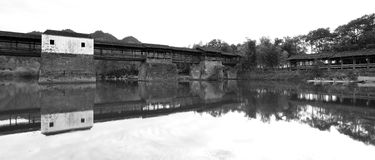 The Chinese Song dynasty caihongqiao covered bridge in wuyuan county, black and white image. Caihongqiao covered bridge in qinghua village of wuyuan county royalty free stock photo