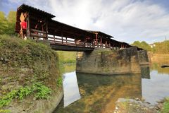 Chinese song dynasty covered bridge in wuyuan county, adobe rgb. During the chinese national day of 2018, tourist visit caihongqiao covered bridge in qinghua stock photo