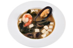 Chinese soup with mussels, mushrooms, diced cheese and shrimp. Stock Photos