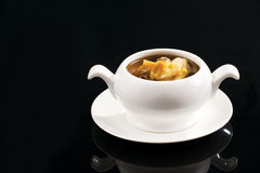 Chinese soup:seashell stew with mushrooms royalty free stock image