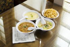Chinese Soups. And crispy noddle. focus on egg drop soup only, the yellow soup Stock Photo
