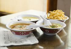 Chinese Soups 2. Chinese soup and crispy noddle. focus on wonton soup only Stock Image