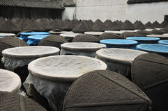 Chinese soy sauce. Large soy sauce urns outside covered in cheesecloth  used to make Xuchang famous soy sauce in Tongxiang's Wuzhen Scenic Area in Zhejiang Stock Image