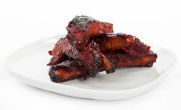 Chinese spare ribs on a plate Stock Images