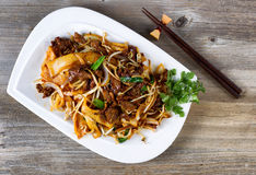 Chinese spicy beef dish in plate setting ready to eat Royalty Free Stock Photo