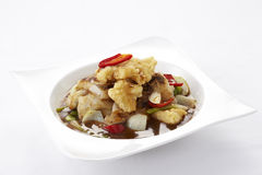 Chinese spicy noodles topped with crispy fish in gravy Royalty Free Stock Images