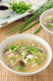 Chinese spicy soup with egg, shiitake mushrooms, tofu and green Royalty Free Stock Photo