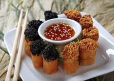 Chinese spring rolls. With chop sticks Royalty Free Stock Photo