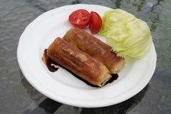 Chinese spring rolls. Spring rolls with meat ,soy, tomato and lettuce Royalty Free Stock Image